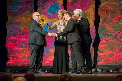 Jason Wilke presents award at 2018 Golden Apple Awards Ceremony