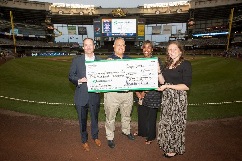 Pictured from left to right: Christopher Piotrowski and Eduardo Herrera-Mier of Associated Bank, Cecilia Gore of Brewers Community Foundation and Mary DeLaat of Milwaukee Brewers.
