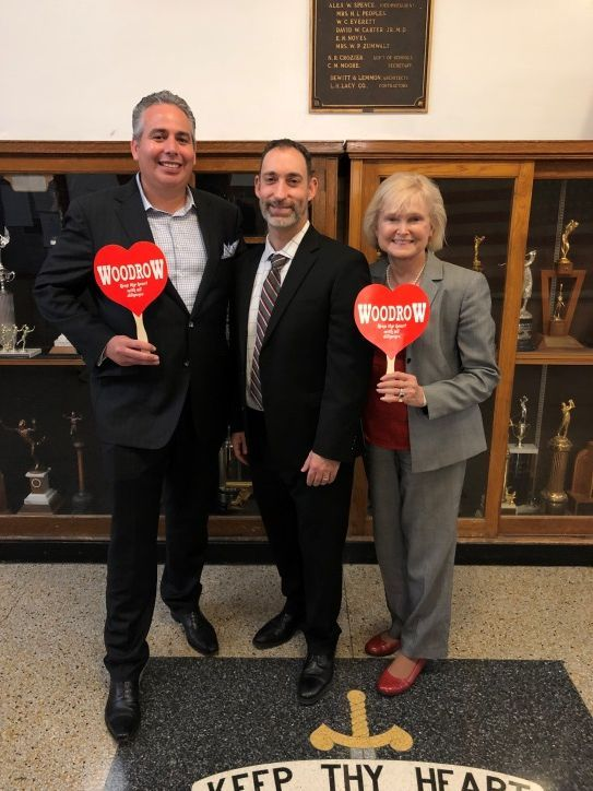 Rob Swift (left) participates in Principal for a Day at Woodrow Wilson High School in Dallas, pictured with Woodrow Wilson High School Principal Michael Moran (center) and Clare Chaney (right).
