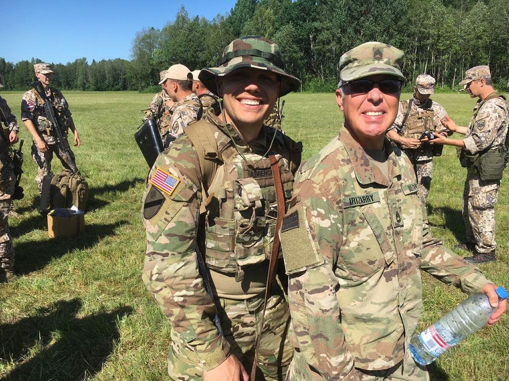 Sgt. 1st Class Tom Irizarry (right) while on deployment to the Baltic states. He's a member of the 432nd Civil Affairs Battalion and works at Associated Bank.