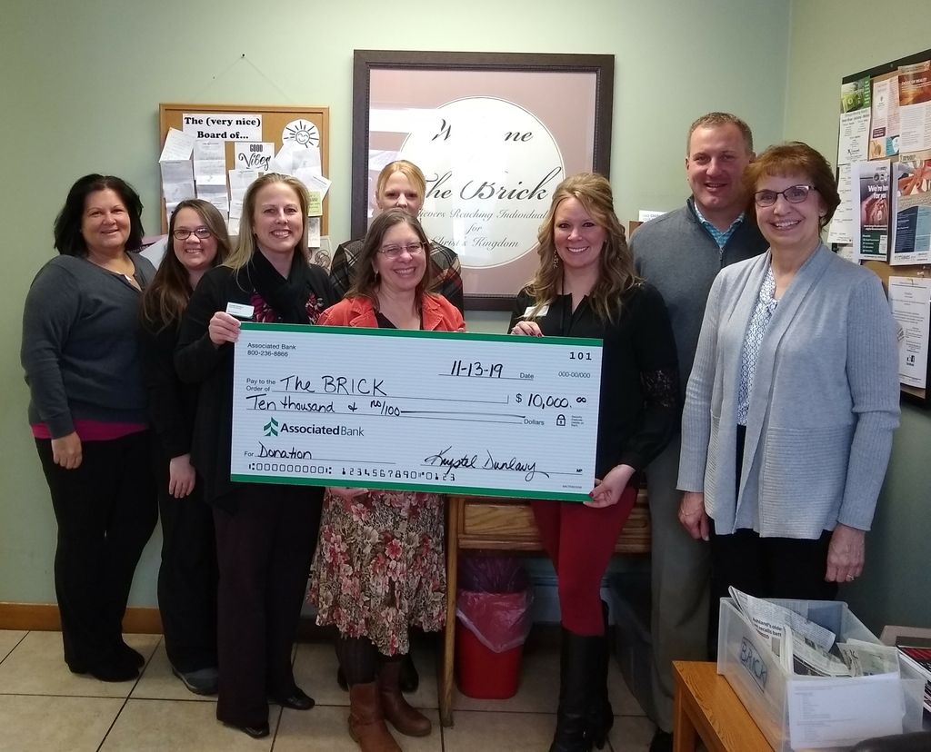 BRICK Board Member Rhonda Sundberg (left), Benevolence Manager Sam Ray, Krystel Dunlavy, BRICK Executive Director Liz Seefeldt, Cynthia Bodoh, Crystal Mattson, Brad Kowieski and BRICK Board Secretary Julie Stipetic.