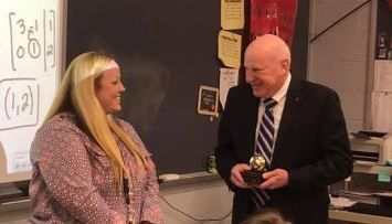 Candice Cortese is surprised with her Golden Apple in the classroom by Golden Apple sponsor, Thomas Kress.
