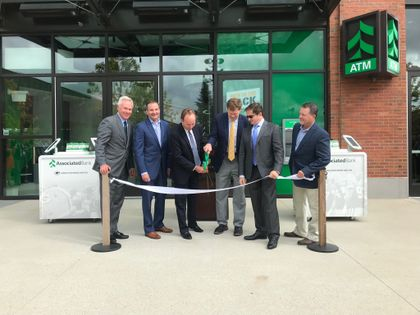 Associated Bank and the Packers celebrated the grand opening of the new Associated branch in Titletown. Pictured from left to right: David Stein, Christopher Piotrowski, Philip Flynn, Mark Murphy, Ed Policy and Craig Benzel.