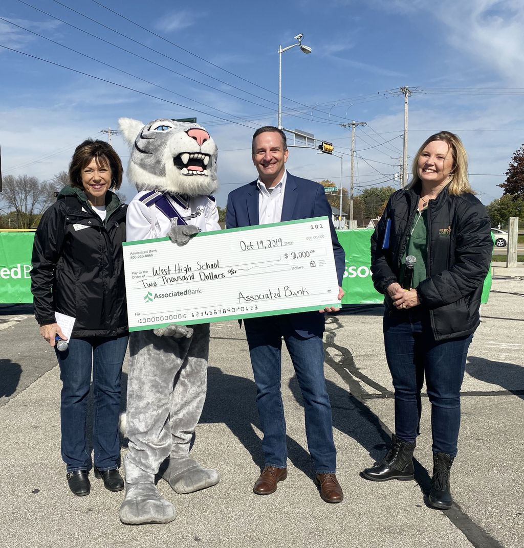 From left to right: Dr. Michelle Langenfeld, Green Bay Area Public School district; Christopher Piotrowski, Associated Bank; and Patti Habeck, Feeding America Eastern Wisconsin presented West High School with a $2,000 grant for the school's music program.
