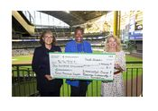 LaDonna Reed, Associated Bank and Cecelia Gore, Brewers Community Foundation, present a $100K check to Wendy Baumann of WWBIC to support minority, women and veteran owned businesses