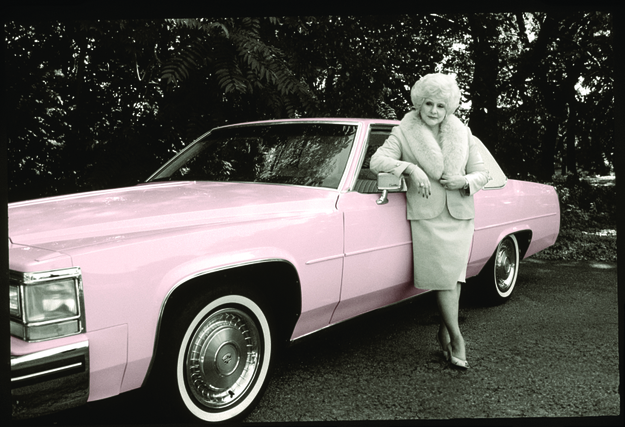 Mary Kay Ash with vintage pink Cadillac.