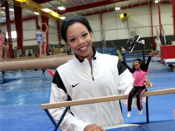 Gabby Douglas with Barbie Doll
