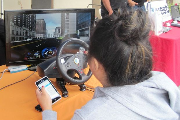 teen at distracted driving simulator