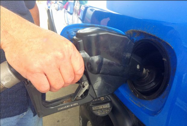 Pumping gas by Mike Mozart
