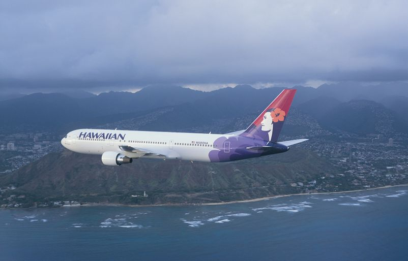Boeing 767 flying over Oahu