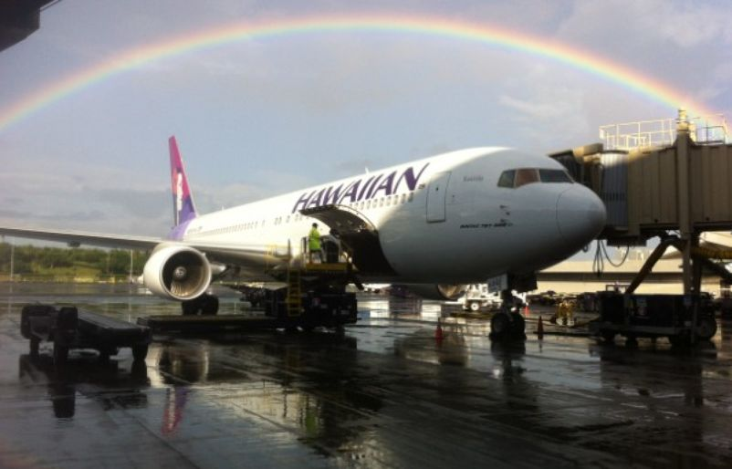 Boeing 767 under rainbow at HNL