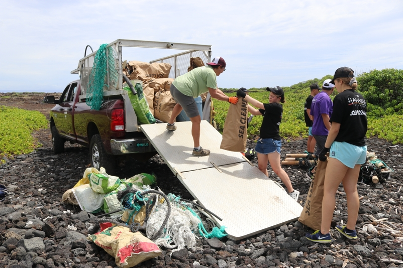 Loading Trucks with Marine Debris