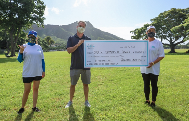 Debbie Nakanelua-Richards presents Dan Epstein and Renee Manfredi of Special Olympics Hawaii with a check for $68K, donated by participants of the Holoholo Challenge