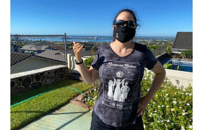 Renee Manfredi flashes a shaka as she earns her mileage around Honolulu