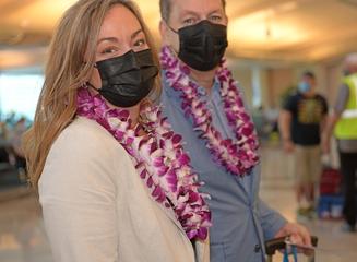 HA85 guests wearing lei