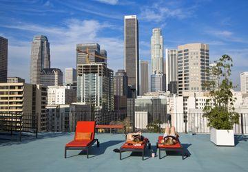 Downtown skyline with sun bathers