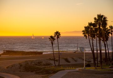 Beach sunset with sailboats