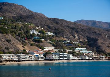 NEED TO RE-ORGANIZE Malibu coast w/paddle boarder
