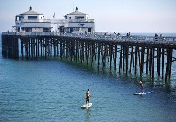 Malibu pier w/paddle boarders