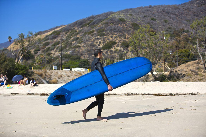 Surfer on sand