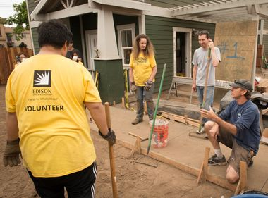 Volunteers Help With Finishing Touches to Long Beach Green Homes
