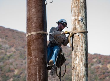 Crews Install Fiberglass Power Poles in High Fire Risk Areas