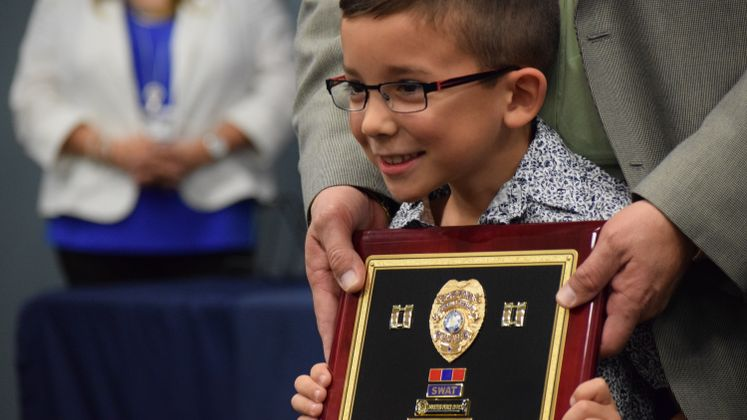CCPD's Capt. J.V. Garcia's grandson receives his retirement plaque