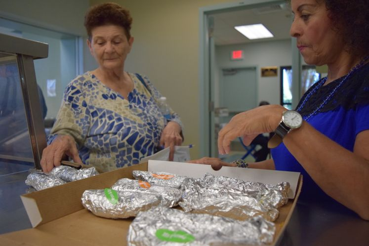 Patrons Celebrating National Taco Day at Broadmoor Senior Center