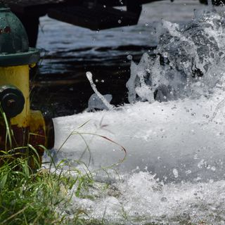 City Employees Demonstrate Comprehensive Water Flushing Program