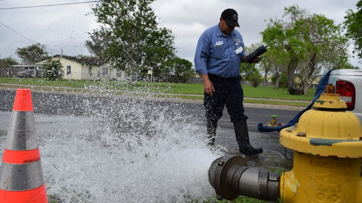 K. Evans Utility Technician Tests Water in Annaville