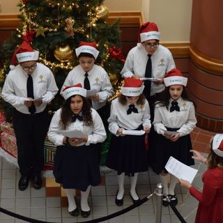 Two Local School Choirs Spread Christmas Cheer at City Hall