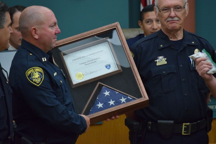 Rockport Police Presents Flag to CCPD