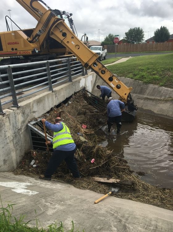 Storm Water Employees Clear Grate Screens of Debris Before Storm