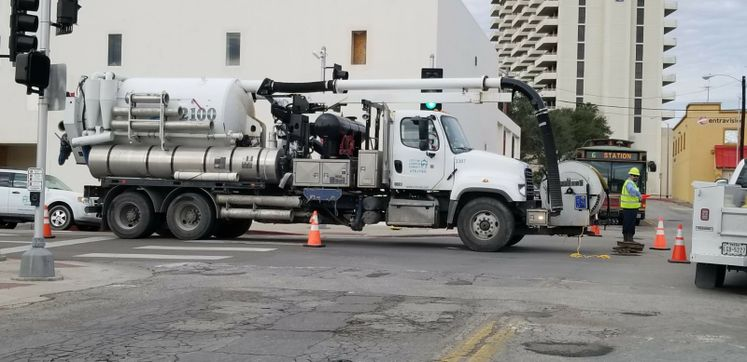 Vactor Truck Performing Maintenance Downtown