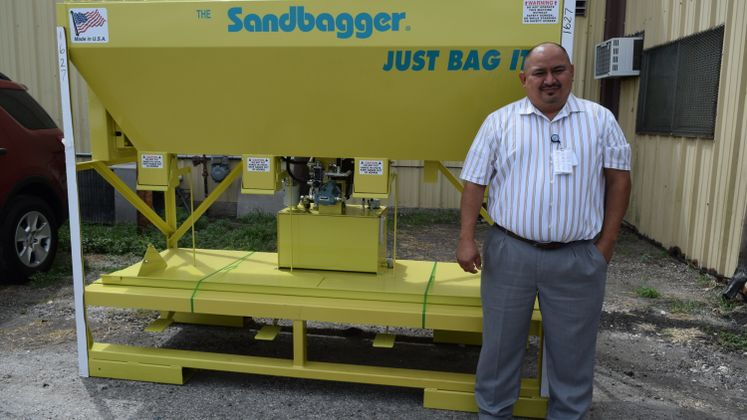 Asst. Director Rolando Mata and the New Sandbagger for Public Works.