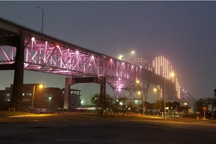 Amber lights at the Harbor Bridge in Honor of COVID Victims