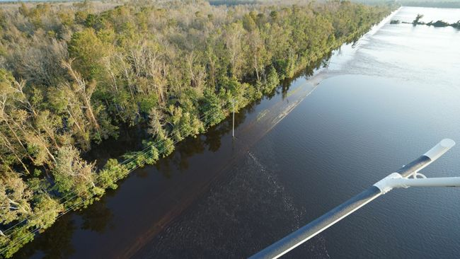 Cape Fear River continues to overtop the north end of the Sutton cooling lake dike. Photo uploaded on Sept. 21, 2018.