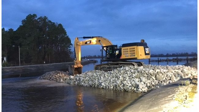Duke Energy constructing a dike to slow the flow of water out of the Sutton Lake overnight. Photo uploaded Sept. 25, 2018.