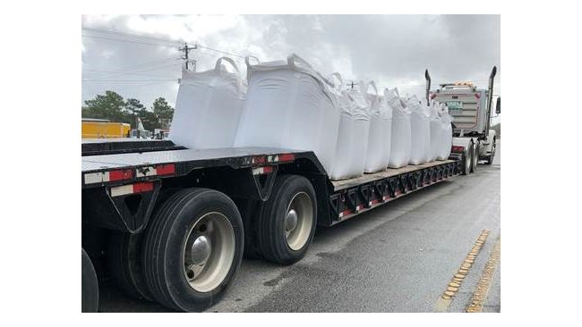 Large sandbags ready to be used to help stop the flow of water out of breached in the Sutton Lake dam. Photo uploaded Sept. 26, 2018.