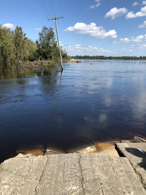 River water continues to flow into Sutton Lake through a breach in the dam. Photo uploaded Sept. 26, 2018.