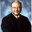Associate Justice Thomas E. Hollenhorst Announces Retirement