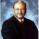 Associate Justice Thomas E. Hollenhorst Announces Retirement