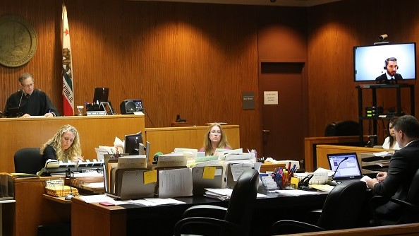 Interpreters in the courtroom via video feed