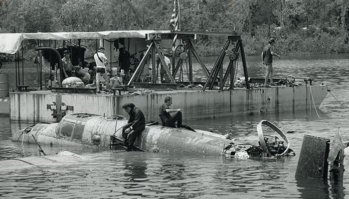 The Navy Reserve led the recovery effort in 1983. Duke Power Company provided a barge to rest the plane on after it was lifted out of the water.