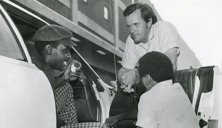 Retro photos: What are these guys talking about?