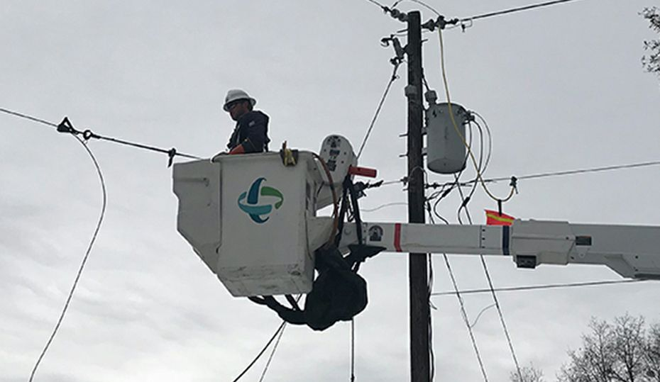 Lineworkers restored power while snow fell for second day