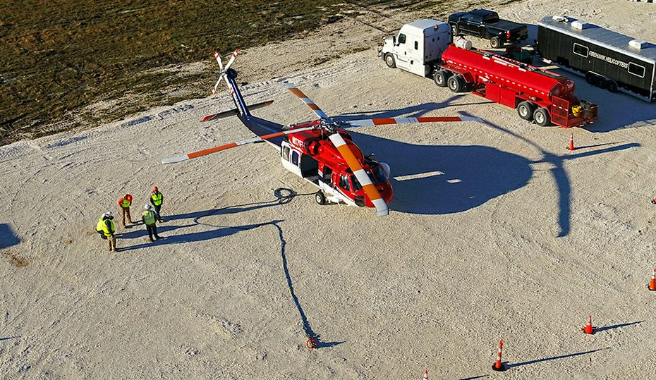 Helicopters replace massive transmission lines toppled by Hurricane Michael