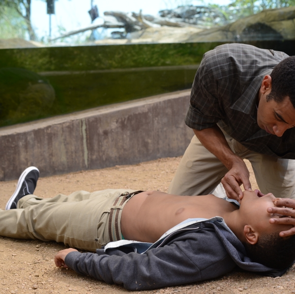 Man administers CPR to child in reenactment illustrating proper technique.copyright American Heart Association