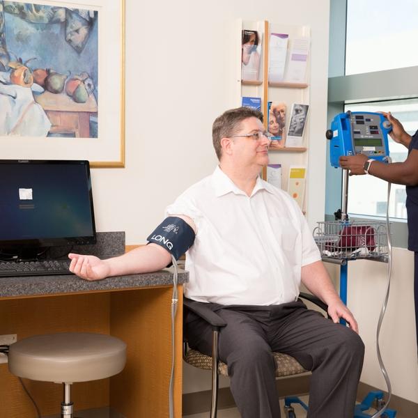 Male patient BP check by nurse