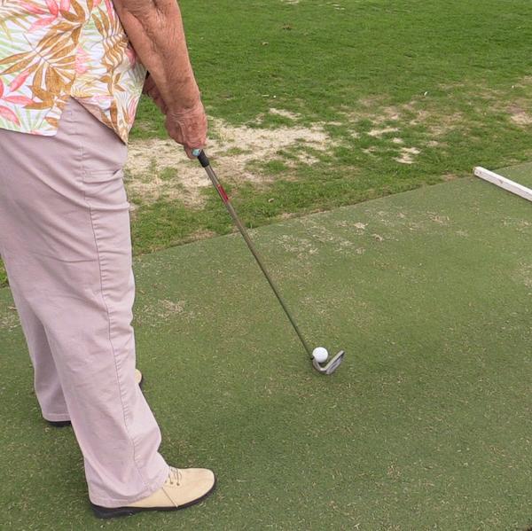 Woman+golfing